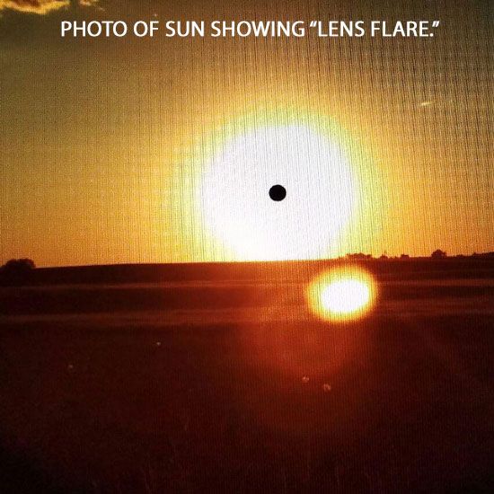 PHOTO OF SUN SHOWING LENS FLARE EFFECT.