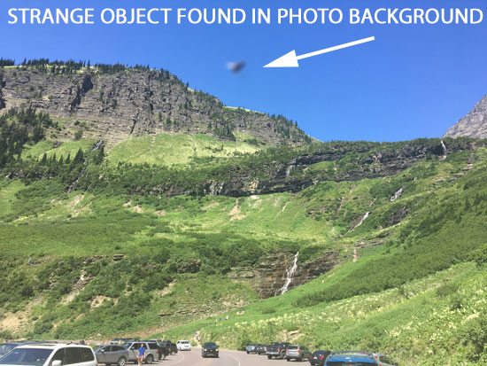 PHOTO SHOWING STRANGE OBJECT IN THE BACKGROUND.